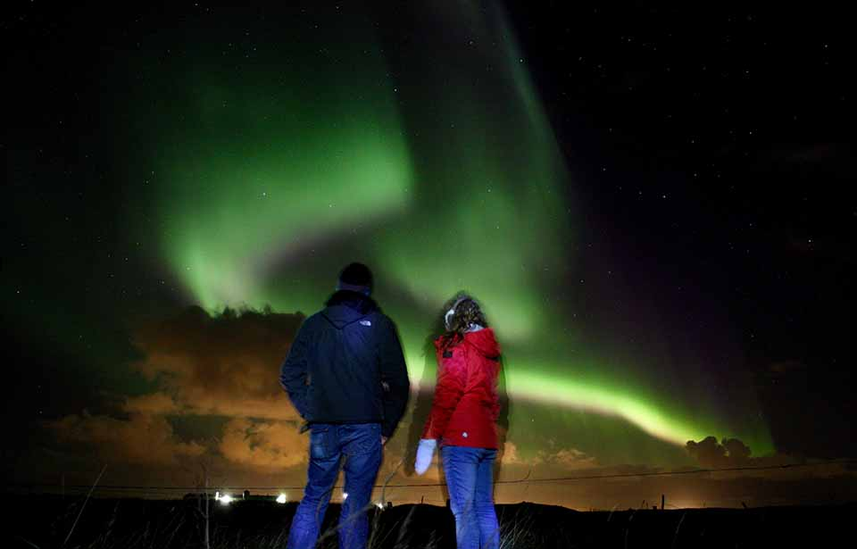 Northern Lights and Stargazing Happy Couple