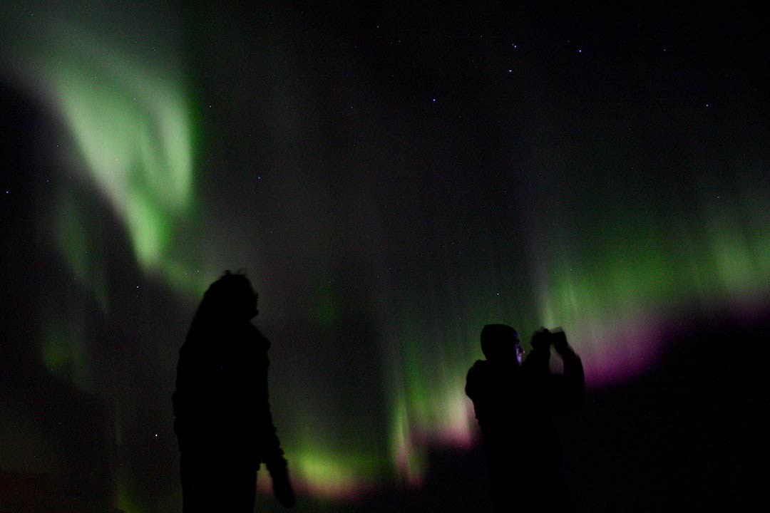 Aurora Borealis pictures colourful silhouette under Northern Lights Iceland